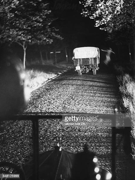 The Uniformed Police of Potsdam during an operation - in the darkness a person jumps from the van - the arrest of gang of thieves - 1932 -...