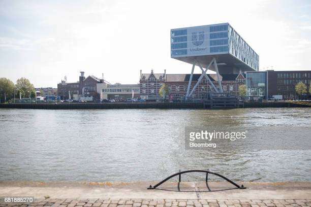 The Unilever logo sits on the Unilever NV headquarter offices as it stands beside the River Maas in Rotterdam Netherlands on Thursday May 11 2017...