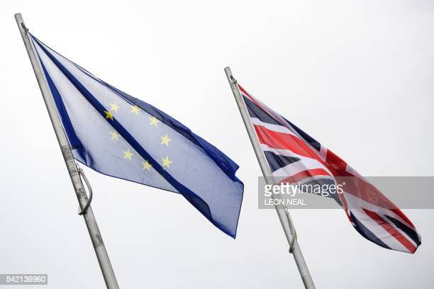 The Union and European Union flags fly outside City Hall in central London on the eve of the EU referendum on 22 June 2016 Opinion polls indicate a...