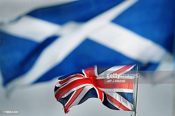 The Union and Saltire flags blow in the wind at the Cowal Highland Gathering on August 30 2013 in Dunoon Scotland First held in 1894 the Cowal Games...