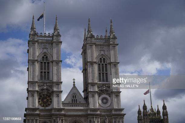 The Union Flag atop Victoria Tower over the Houses of Parliament and the flag of Westminster Abbey fly at half-mast in central London on April 9,...