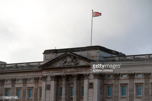 The Union Flag flies at Buckingham Palace in central London on January 13 2020 Queen Elizabeth II and other senior British royals were gathering for...