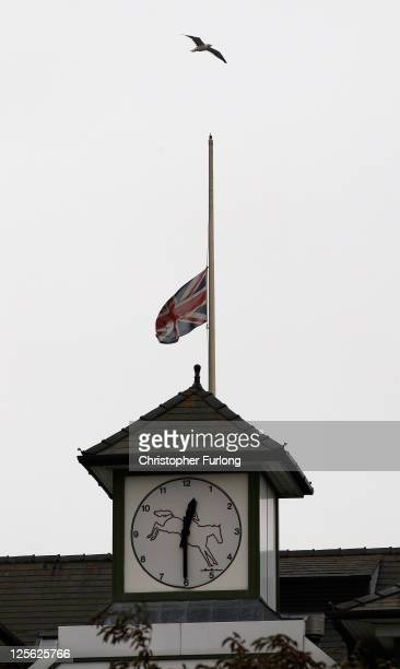 The Union Flag flies at half mast in honour of the late racehorse trainer Ginger McCain at Aintree Racecourse on September 19 2011 in Liverpool...
