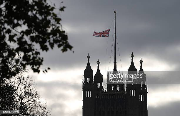 The Union flag flies at half mast on Victoria Tower Parliament the day after the announcement of the death of Nelson Mandela on December 6 2013 in...