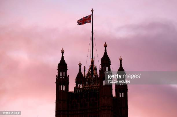 The Union Flag flies from the top of Victoria Tower at the Palace of Westminster, home to the Houses of Parliament, in London on January 18, 2021.