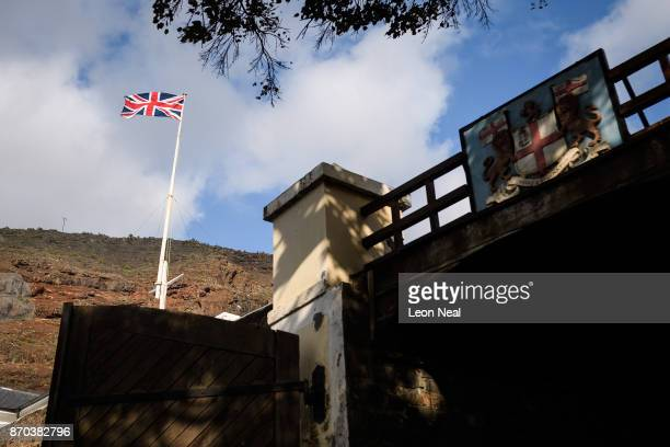 The Union Flag flies over the harbour area on October 24 2017 in Jamestown Saint Helena Following the introduction of weekly flights to the island...