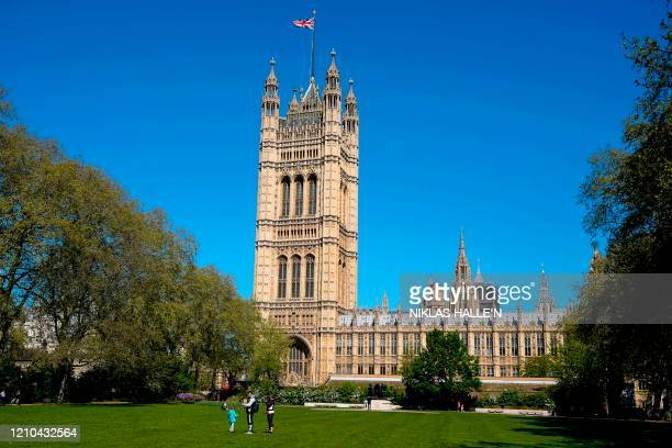 The Union flag flutters in the breeze on top of the Victoria Tower part of the Palace of Westminster in central London on April 20 during the novel...