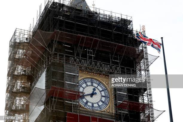 The Union flag flutters near the clockface of Big Ben during ongoing renovations to the Tower and the Houses of Parliament, in central London on...