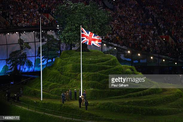 The Union flag is raised by service personnel of the British Armed Forces during the Opening Ceremony of the London 2012 Olympic Games at the Olympic...