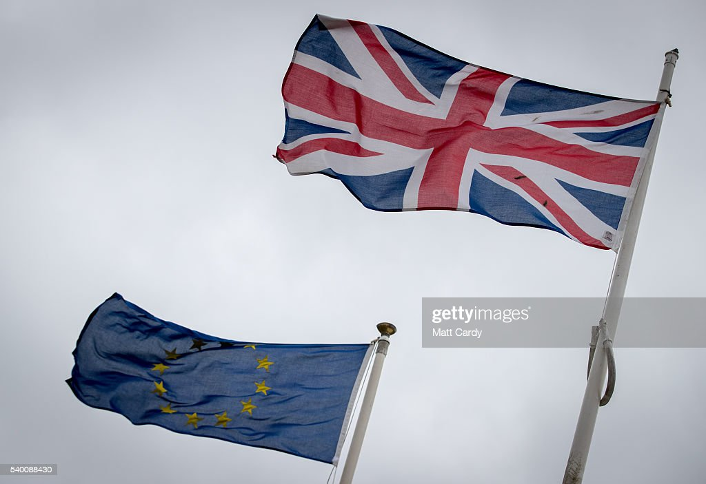 The Union Jack flag flies besides the flag of the European Union in front of City Hall on June 14, 2016 in Cardiff, Wales. The UK goes to the polls next Thursday, June 23, to decide whether Britain should leave or remain in the European Union.