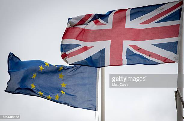 The Union Jack flag flies besides the flag of the European Union in front of City Hall on June 14 2016 in Cardiff Wales The UK goes to the polls next...