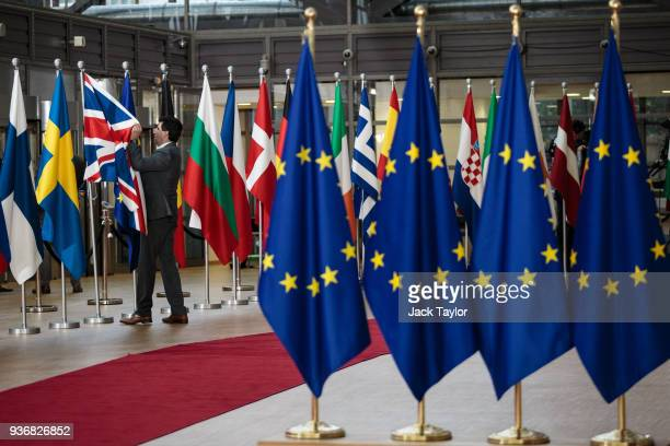The Union Jack flag is arranged by an employee at the Council of the European Union on the final day of the European Council leaders' summit on March...