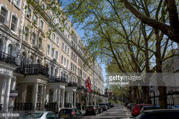The union Jack flies from a property balcony in Beaufort Gardens on 9th April 2017 in Knightsbridge London SW3 England