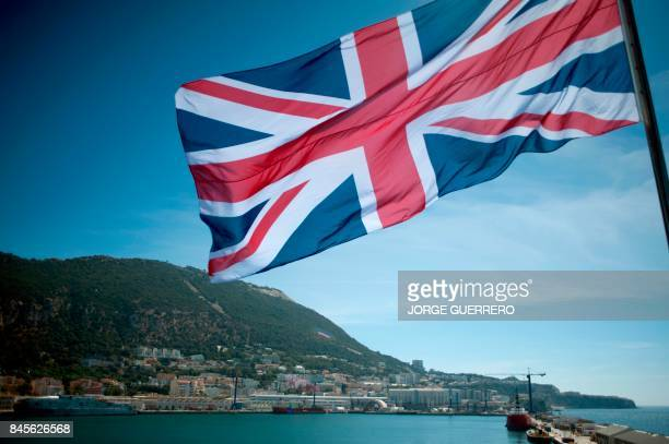 The Union Jack flies on board the Royal Navy amphibious assault ship HMS Ocean anchored at the Naval Base in Gibraltar on September 11 before...