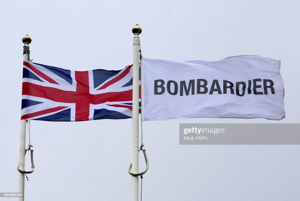 The Union Jack flutters alongside a Bombardier flag outside the Bombardier headquarters and factory in Belfast on September 27, 2017. The US Commerce Department on September 27, 2017, said it would impose anti-dumping duties of 220 percent on Bombardier's CSeries jets, following an investigation into state subsidies sparked by a Boeing complaint. / AFP PHOTO / Paul FAITH