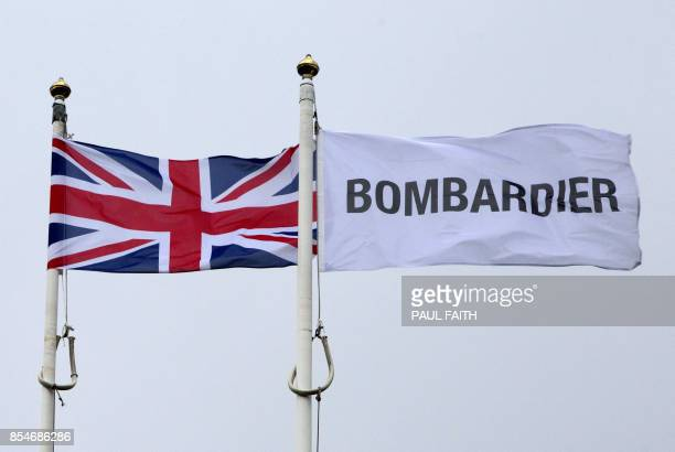 The Union Jack flutters alongside a Bombardier flag outside the Bombardier headquarters and factory in Belfast on September 27 2017 The US Commerce...