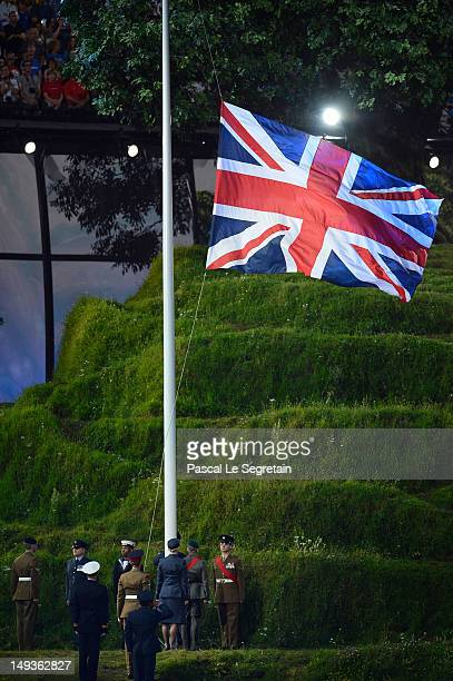 The Union Jack is raised during the Opening Ceremony of the London 2012 Olympic Games at the Olympic Stadium on July 27, 2012 in London, England.