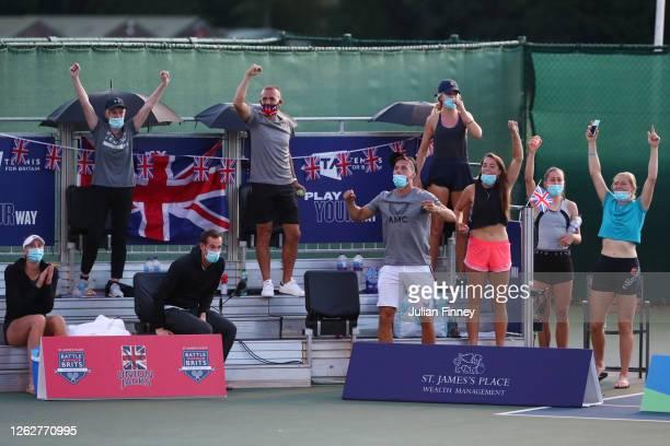 The Union Jacks' bench celebrates after Heather Watson and Jamie Murray of Union Jacks won their mixed doubles match against Joe Salisbury and Emma...
