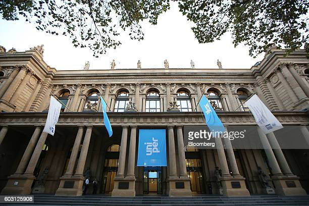 The Uniper SE logo sits on banners flying outside the Frankfurt Stock Exchange as Uniper makes its initial public offering in Frankfurt Germany on...