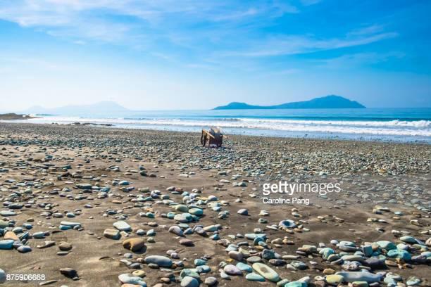 The unique Blue Stones Beach in Flores, Indonesia.