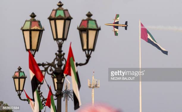 The United Arab Emirates' AlFursan National Aerobatic Team performs along the corniche of the capital Abu Dhabi on December 1 during celebrations...