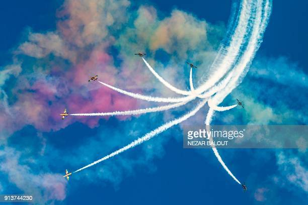 TOPSHOT The United Arab Emirates' AlFursan National Aerobatic Team performs with smoke during the 2018 Red Bull Air Race World Championship in the...