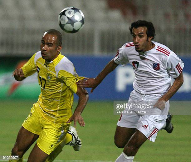 The United Arab Emirates' AlWasl player Alexander Olivera competes with Fahd Odah of Kuwait club during their GCC clubs championship Group D match in...