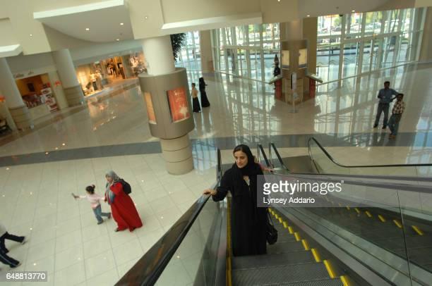 The United Arab Emirates' Minister of Economics Sheikha Lubna Khalid Al Qasimi rides the escalator of her office building in Abu Dhabi United Arab...