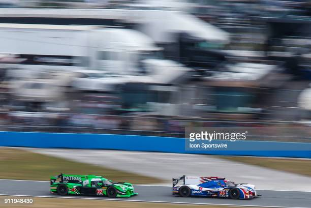 The United Autosports Ligier JS P217Gibson of Fernando Alonso Phil Hanson and Lando Norris and The Tequila Patron ESM Nissan DPi of Pipo Derani...