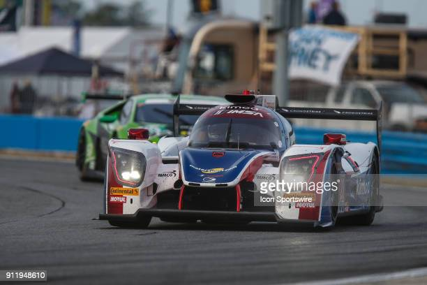 The United Autosports Ligier JS P217Gibson of Fernando Alonso Phil Hanson and Lando Norris races through a turn during the Rolex 24 at Daytona on...