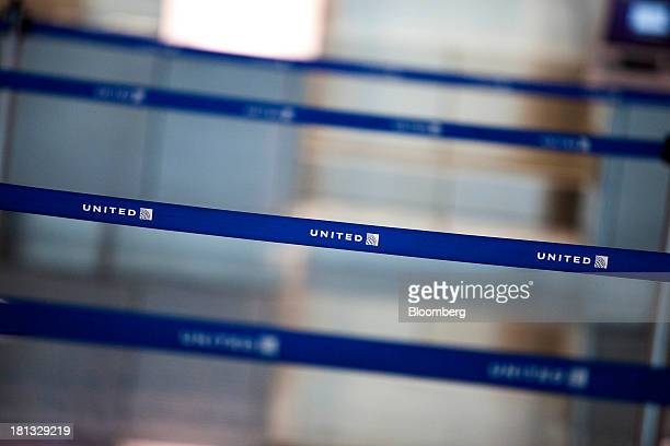 The United Continental Holdings Inc logo is displayed on line dividers at San Diego International Airport in San Diego California US on Thursday Sept...