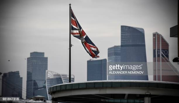 The United Kingdom flag flies outside its embassy in Moscow on March 14 2018 Britain will expel 23 Russian diplomats over the nerve agent attack on a...