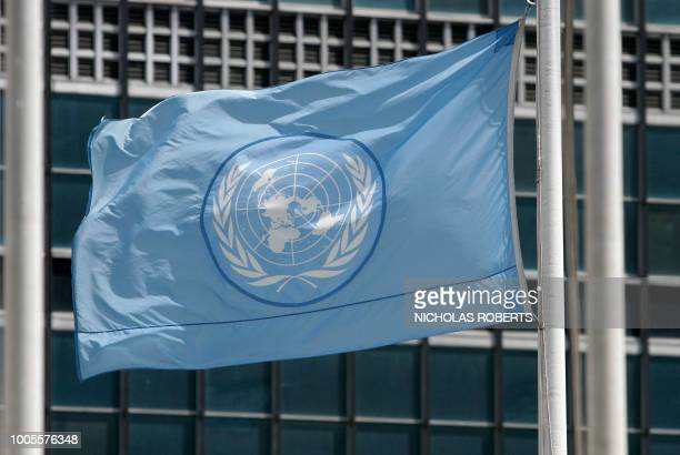 The United Nations flag flies at half-staff at UN headquarters in New York 15 June 2007.
