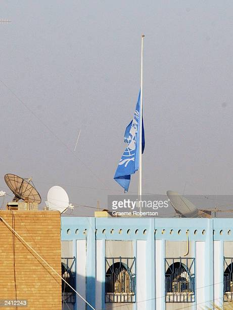 The United Nations Flag flutters at half mast at the United Nation headquarters on August 20 2003 in Baghdad Iraq A huge blast ripped through the...