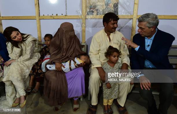 The United Nations High Commissioner for Refugees Filippo Grandi interacts with an Afghan refugee family as Mahira Khan actress and UNHCR advocate...