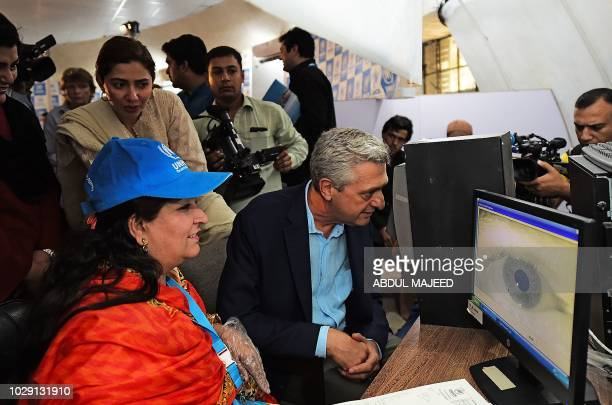 The United Nations High Commissioner for Refugees Filippo Grandi inspects the eye scanner during his visit at the Azakhel Voluntary Repatriation...