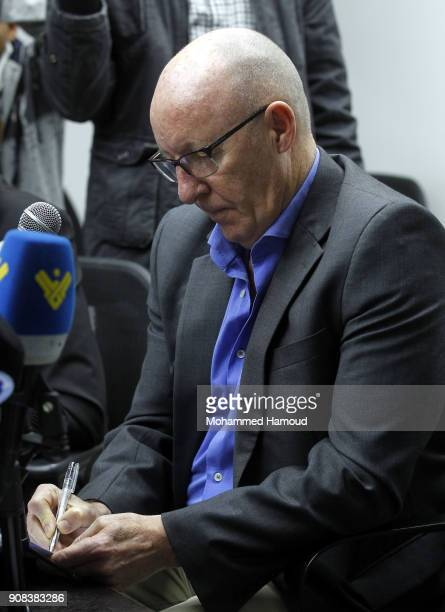 The United Nations Humanitarian Coordinator in Yemen Jamie McGoldrick writes as he listens to questions during a press conference on January 21 2018...