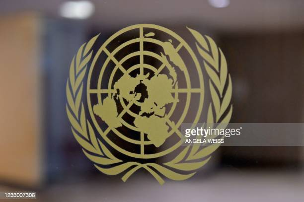 The United Nations logo is seen at the United Nations headquarters on May 20, 2021 in New York City. - Israel faced an escalating conflict on two...