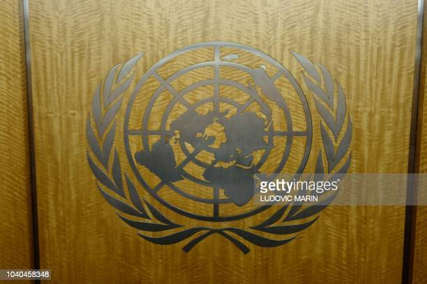 The United Nations logo is seen in the corridors of the United Nations headquarters in New York City on September 25, 2018 during the annual general...