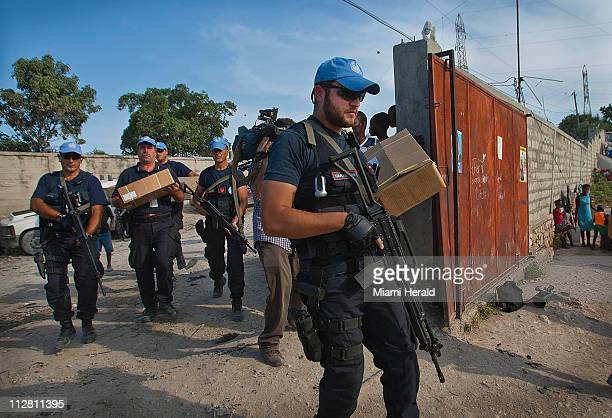 The United Nations provides security for the deliverance of voting ballots and other materials to polling stations in PortauPrince Haiti on Saturday...
