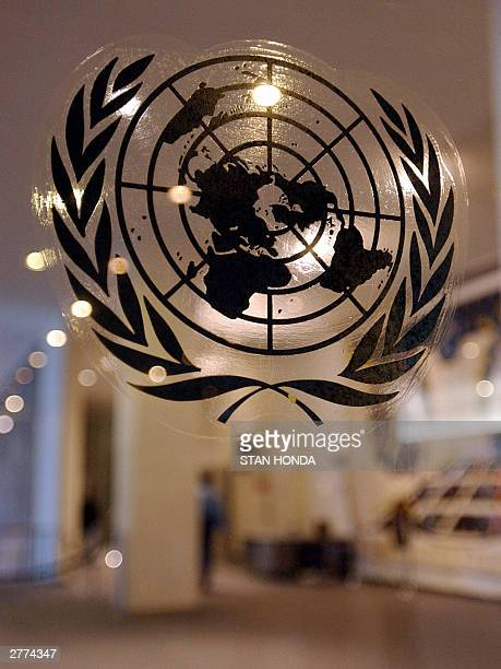 The United Nations seal is shown on a glass wall at an entrance 01 December near where a body was found at UN headquarters in New York A security...