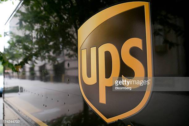 The United Parcel Service Inc logo is seen on the side of a delivery truck in Washington DC US on Monday July 22 2013 UPS is expected to release...