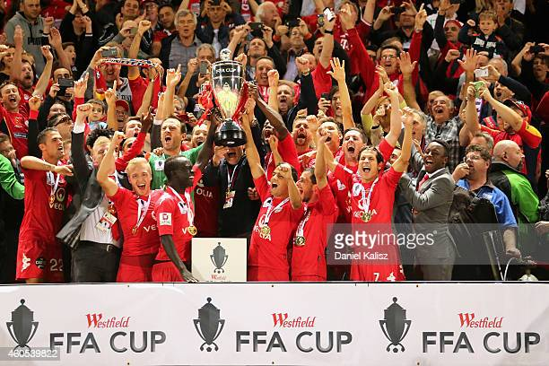 The United players celebrate after the FFA Cup Final match between Adelaide United and Perth Glory at Coopers Stadium on December 16 2014 in Adelaide...