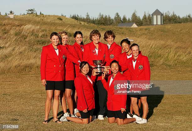 The United Staes team poses with the Curtis Cup after defeating Great Britain Ireland 11 1/2 to 6 1/2 during the afternoon singles competition of...