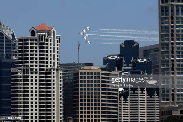 The United States Air Force Thunderbirds do a fly over in solidarity with healthcare and frontline workers as the coronavirus global pandemic...