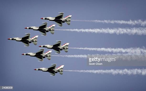The United States Air Force Thunderbirds fly over the crowd gathered at the 45th annual Chicago Air and Water Show August 17 2003 in Chicago Illinois...