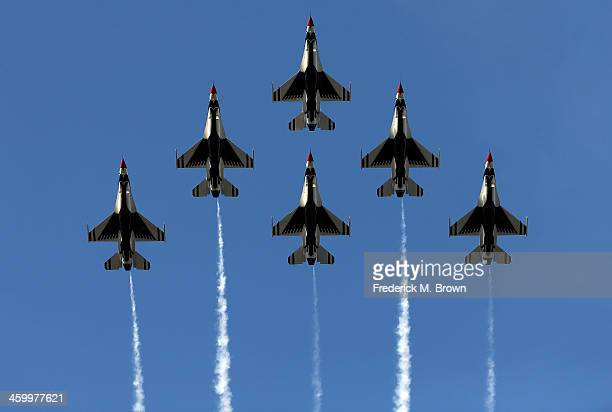 The United States Air Force Thunderbirds fly over the parade route during the 125th Rose Parade on January 1 2014 in Pasadena California
