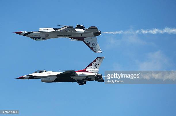 The United States Air Force Thunderbirds perform aerobatic maneuvers during the Rocky Mountain Air Show at the Aurora Reservoir May 30 2015 The USAF...