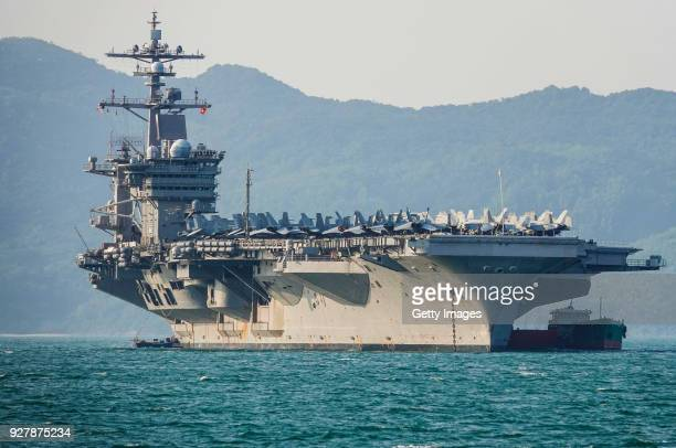 The United States aircraft carrier USS Carl Vinson anchored off the coast at Tien Sa Port on March 5 2018 in Danang Vietnam A United States aircraft...