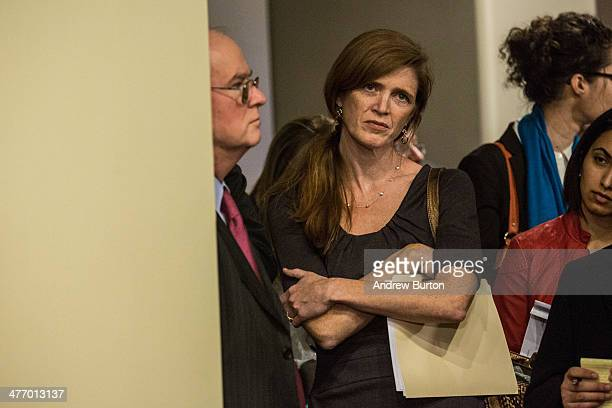 The United States' Ambassador to the United Nations Samantha Power listens while the Russian Ambassador to the United Nations Vitaly Churkin speaks...
